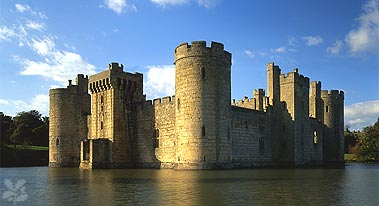 The majestic exterior of Bodiam Castle rising steeply from the waters of the moat